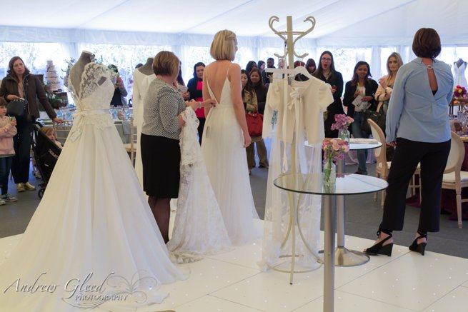 Bride model and wedding dresses on mannequin