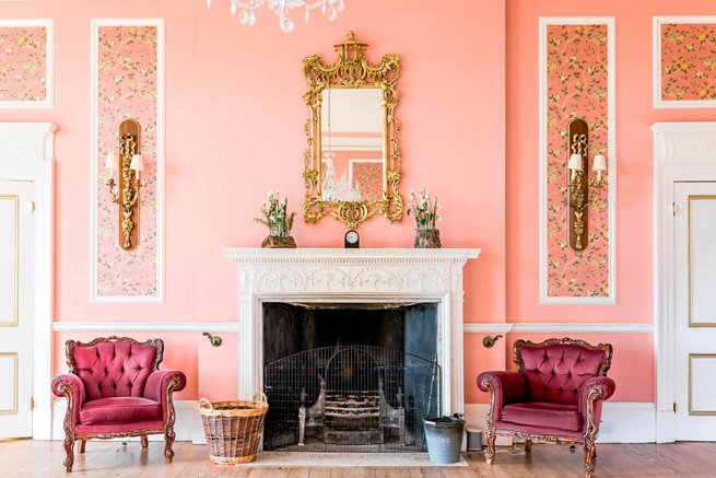 Interior room pink chairs by fire place | Kelly Chandler Consulting