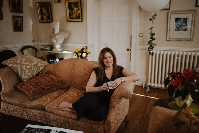Lady on sofa drinking tea | Kelly Chandler Consulting