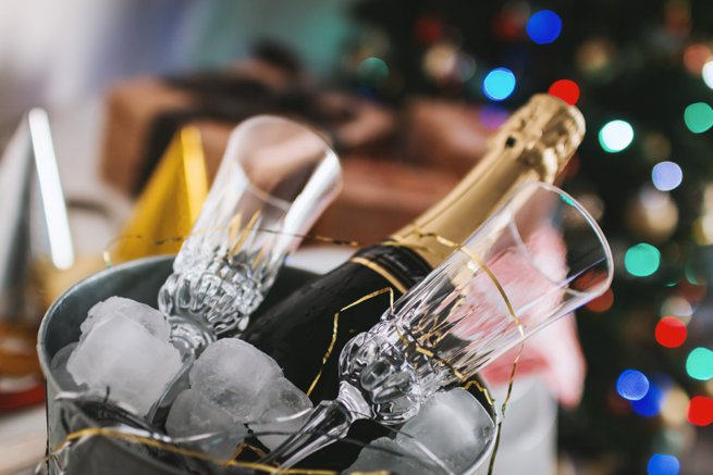 Champagne and glasses in an ice bucket | Kelly Chandler Consulting