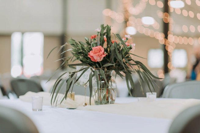 Vase coral flower and leaves in table centrepiece | Kelly Chandler Consulting