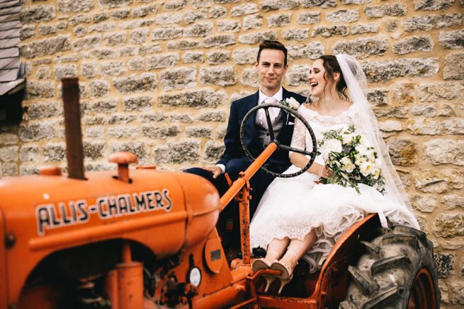 Huntsmill Farm Wedding couple on an orange tractor | Kelly Chandler Consulting