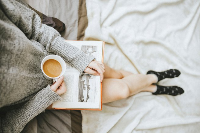 girl with a coffee reading | kelly chandler Consulting
