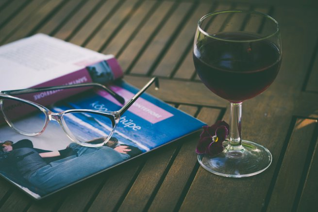 reading glasses book and a glass of red wine | Kelly Chandler consulting
